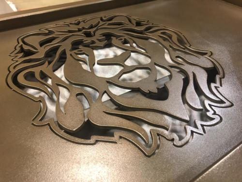 Waterjet cut lions head logo